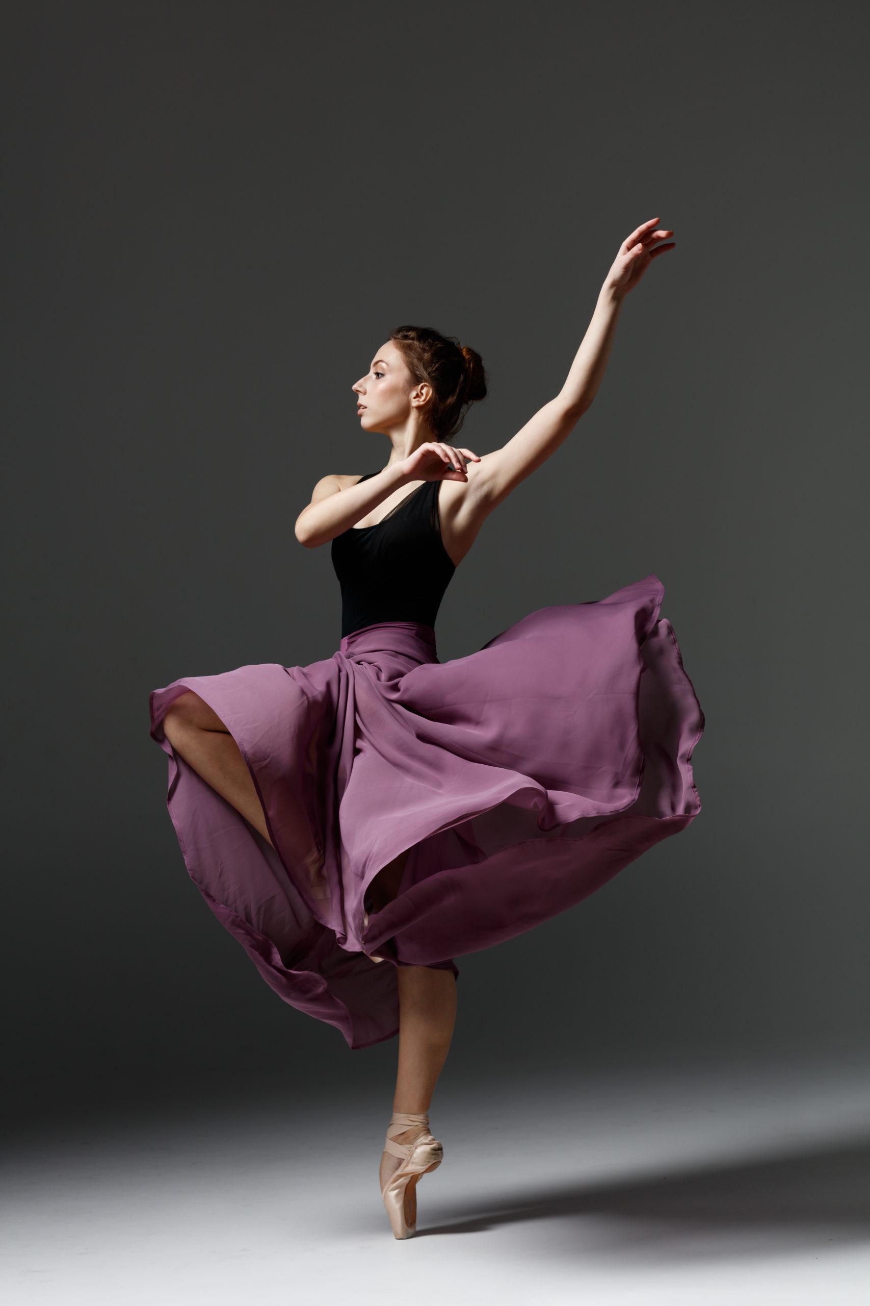 Young beautiful ballerina is posing in studio @ ayakovlev_com